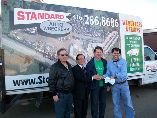 100000 trees cheque at standard auto wreckers